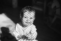 Puzzle Teeth (mravcolev) Tags: light portrait blackandwhite bw baby cute window girl monochrome smile analog kid toddler shadows child naturallight analogue ilford fp4 nikonfe2 id11 homedevelopment nikkor50mm14ais epsonperfectionv700