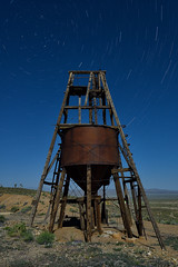 headframe. gold point, nv. 2016. (eyetwist) Tags: longexposure shadow sky building mill abandoned architecture night silver dark underground dead photography gold nikon ruins mine long exposure desert head decay empty nevada ruin rusty wideangle landmark mining fullmoon nv dirt american highdesert frame americana deathvalley lonely nikkor skip desolate derelict nocturne beatty shaft goldrush startrails typology mojavedesert headframe goldpoint eyetwist npy 1024mm orebucket d7000 capturenx2 eyetwistkevinballuff 1024mmf3545g ohiomine americantypology