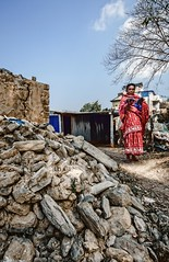 A women standing next to her old collasped house, Nagarkot, Nepal. (SUNA_PHOTOGRAPHY) Tags: nepal nikon photojournalism lifestyle survivor recovering earthquak