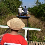Boy Watching Another Bamboo Train Ahead of Us thumbnail