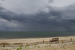 No One Watching (brucetopher) Tags: cloud storm beach rain weather bench watch stormy gale beaches cloudscape raincloud foulweather cloudpatterns