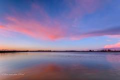Arrow (Ellen van den Doel) Tags: sunset sky cloud sun lake color reflection nature water netherlands landscape zonsondergang meer nederland natuur nl lucht polder zon plas landschap wolk zuidholland kleur reflectie flakkee stadaanhetharingvliet trotsopflakkee goereeoverfklakkee