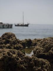 Macro Rocky Surface with a Boat off Focus (esseffdeearr) Tags: portugal algarve olhos dagua riu guarana praia da falesia albufeira portimao vacation