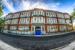 PS 41 (Glenn Heckman) Tags: school building architecture photoshop photography security fisheye sunburst blueskies 12mm hdr bluedoor brickbuilding lightroom ps41 urbex multipleexposures queensny publicschool wideanglephotography barsonwindows whatisawinnyc