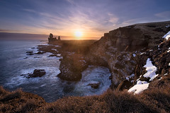 The Cliff of a Thousand Birds (TheFella) Tags: ocean travel winter light sunset sky outcrop cliff sun sunlight seagulls snow slr bird nature water grass birds rock clouds digital photoshop landscape island bay coast photo iceland nikon rocks europe european waves cloudy dusk gulls fineart arctic photograph processing inlet nordic burst dslr sunrays peninsula hdr highdynamicrange sland starburst crashing nesting snfellsnes d800 icelandic postprocessing travelphotography photomatix westiceland snfellsnespeninsula thefella conormacneill thefellaphotography
