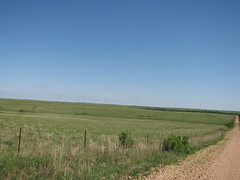 Rest Stop at Beaumont, KS. (tomcomjr) Tags: flowers blue trees sky green fall grass barn spring day sunny bluesky windmills reststop flinthills turbines highway400 beaumontks clearskies canonpowershots3is oldhighway54