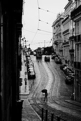 Crossing the street (t3mujin) Tags: umbrella tram rain autumn city europe fall lisboa lisbon portugal season street weather pt bw joaoalmeidaoctoberportfolio fav10
