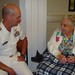 CHARLESTON, S.C. (April 14, 2010) Rear Adm. Bill Goodwin, Assistant Chief of Naval Operations for the Next Generation Enterprise Network (NGEN), shares a moment with World War II Army veteran Josephine Hutchingson at the Ralph H. Johnson VA Medical Center