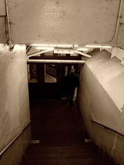 out the door (Robert S. Photography) Tags: door man sepia brooklyn stairs subway leaving canonpowershot