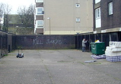 Grim scene in Leith, Scotland (Tony Worrall) Tags: uk man writing concrete graffiti scotland alley edinburgh grim candid country north courtyard scene flats rubbish council leith slogan share scots garages 2013tonyworrall
