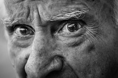 Fear inside his eyes (Giulio Magnifico) Tags: old man black detail macro reflection eye look closeup lights alone loneliness shadows emotion expression candid character teeth fear profile streetphotography streetportrait sharp terror aged gaze glance glacial udine nikond800e nikkormicro105mmafsvrf28