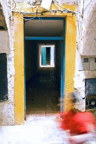 africa door blue red house playing blur yellow stairs football child north running morocco medina essaouira mogador