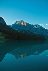 Dawn at Emerald Lake (aitramah) Tags: morning blue mountain lake canada mountains nature water vertical forest landscape dawn emeraldlake verticallandscape verticalphotography verticalnature