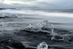 Melting away... (OR_U) Tags: ocean longexposure sea motion ice beach landscape coast iceland movement glacier le shore coastline oru atlanticocean blackbeach jkulsrln 2016 iceblock