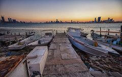 the old jetty (azahar photography) Tags: city sea water backlight boat bahrain jetty middleeast litter arab yatch muharaq manma