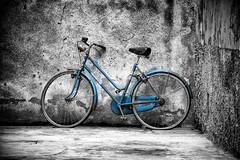Abandoned bicycle (Mario Ottaviani Photography) Tags: blackandwhite bw white black abandoned monochrome bicycle grey monocromo blu sony gray bn cycle tamron bergamo bianco nero biancoenero selective selectivecolor 70300 bergamoalta sonyalpha laea3