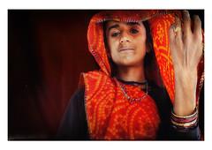 beneath the veil (handheld-films) Tags: red portrait people woman india closeup female eyes women warm veil bright indian portraiture gaze direct unveiled