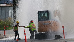 Water Main Spraying In Air (bcfiretrucks) Tags: street new light canada news west water westminster vancouver work photography tv construction media day bc metro accident air main police mini columbia british safe geyser brunette skytrain incident spraying braid excavator gushing