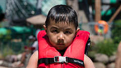 LIFE JACKET AT THE DELLS (r3ddlight) Tags: park water wisconsin photo sony dells asianboy portriat sonya6300 sony85mmgm