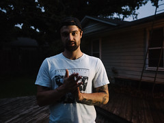 Drew (BurlapZack) Tags: portrait house home beard spring lowlight backyard bokeh availablelight cigarette bbq birthdayparty tattoos dude neighborhood birthdayboy handheld barbeque springtime smokebreak pack01 dentontx badbeats vscofilm olympusmzuiko17mmf18 olympusomdem5markii