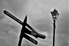 Posts by the Coast (Jaffaeatingacake) Tags: light sky white signs black lamp monochrome weather silhouette clouds d50 walking landscape photography scotland nikon with post cloudy taken places signpost greyscale jaffaeatingacake