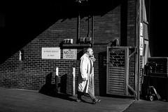 The Butcher (EyeOfTheLika) Tags: street old shadow portrait people white man black monochrome walking photography one adult market candid coat profile lika farringdon 500px ifttt