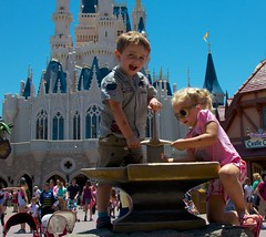 Cash and Elizabeth Use a Little Teamwork Trying to Get The Sword Out of The Stone - Magic Kingdom - 5.13 (meanderingmouse) Tags: travel disney cash sword canonef24105mmf4lis