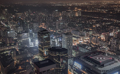 City (Grid) (tomms) Tags: city roof urban streets lines skyline night buildings grid lights downtown glow cityscape rooftops highways metropolis intersections rooftopping