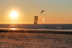 DSC_7049b (meine.augenblicke) Tags: sun beach sport strand abend meer wasser sonnenuntergang sunsets northsea nordsee 2009 gegenlicht baltrum kitesurfen warmefarben kameranikond80