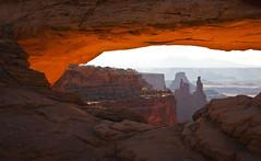 view through Mesa Arch - morning - Canyonlands NP - 6-8-08  02 (Tucapel) Tags: morning light sunrise utah nationalpark canyonlands moab southernutah mesaarch reflectedlight pwlandscape