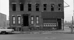 The 1970s were not kind to Jersey City. The corner of Montgomery and Monmouth Streets shows a scene of complete urban desolation in 1975. (wavz13) Tags: dark buick ruins vintagecar sad pollution urbanruins bleak boarde
