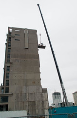 Going In! (Jocey K) Tags: newzealand sky people building architecture crane demolition nz cbd digger christchuch victoriasqapartmentsdemolition