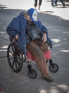 An elderly homeless victim in goes to a mission in a wheelchair for th
