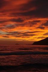 IMG_9986 (Little Pianist) Tags: sunset red sea orange sun seaside tramonto mare harbour porto sole marinadicarrara catchycoloursred