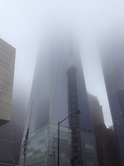 Freedom Tower Fog (jc1305us) Tags: city nyc sky usa newyork building tower fog skyline architecture clouds skyscraper freedom construction unitedstates crane manhattan flag 911 structure wtc portauthority freedomtower panynj
