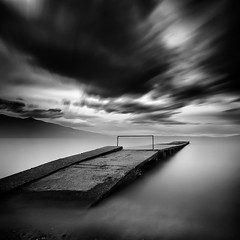 Pier (Ilias79) Tags: longexposure light sea blackandwhite seascape motion water monochrome clouds contrast canon landscape mono pier mood ilias ndfilter varelas