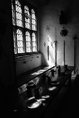 Cotehele, Great Hall (jimmybob49) Tags: light shadow blackandwhite bw window dark table hall blackwhite tudor swords nationaltrust spear lightanddark greathall cotehele halberd cotehelehouse