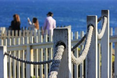 This side of the fence (Eduardo Ruiz M.) Tags: blue light sea lighthouse white fence coast outdoor