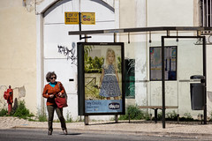 'My Chicco' (Canadapt) Tags: woman building portugal hydrant poster child lisbon busstop advertisement alfama canadapt