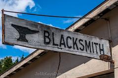 Blacksmith (jsnmckenzie) Tags: old history sign bc handmade britishcolumbia vancouverisland blacksmith trade luxton woodsign langfordbc