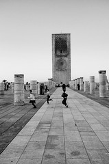running in the ruins [explored 3/18/2014] (Claudia Merighi) Tags: blackandwhite tower blancoynegro monochrome children ruins noiretblanc bambini pavement stones joy happiness running pb ruinas jugar column enfants pretoebranco rabat jeu gioco correr ninos svart columnas jouer giocare correre blek blackandwhitephotos blackwhitephotos blackandwhiteonly fotografiadistrada schwarzweisfotos pentaxk5 lamerighi claudiamerighi bleksvart