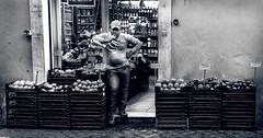 Tired (.::CaoSCalmO::.) Tags: street light shadow people bw italy man rome roma fruits photography blackwhite nikon italia bn tired frutta bianconero greengrocer d300 verdura stanco