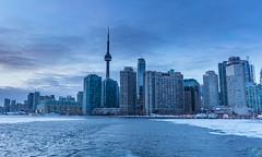 Toronto skyline captured from the ferry on frozen lake Ontario (santoshsurneni photography) Tags: city sky lake toronto ontario canada skyline frozen cntower sony alpha nex