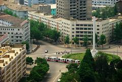 Pyongyang /  (North Korea) - View from Juche Tower (Danielzolli) Tags: circus roundabout tram korea streetcar tramway northkorea kreuzung strassenbahn tatra tramvaj tranvia pyongyang bim tramwaj corea coreadelnorte kore kreisel koryo nordkorea kldr koreja  noordkorea  coredunord   coreadelnord  pjngjang demokratischevolksrepublikkorea dprkorea koreapnocna severnkorea   pjongjang    severnakoreja pionyang dvrkorea szakkorea sjevernakoreja
