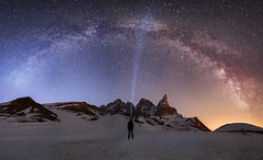 Lost in the cosmic infinity (Luca Matassoni) Tags: longexposure travel wild sky people italy panorama mountain snow lightpainting man mountains cold travelling nature night trekking canon stars landscape photography lights freedom landscapes italia loneliness nightscape hiking wildlife exploring horizon free bluesky wanderlust traveller mount explore photograph canon5d lonely universe cosmic wandering trentino greatness clearsky traveler milkyway naturephotography landscapephotography samyang skyporn paledisanmartino wildandnature samyang14mm cosmicinfinity