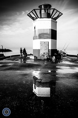 Fishing from the Lighthouse (Michael N Hayes) Tags: sea blackandwhite lighthouse white black netherlands canon pier seaside nederland denhaag thehague