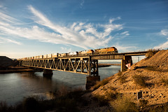 Eureka 014 (Cycle the Ghost Round) Tags: california railroad usa mountains train track flat unitedstatesofamerica engine container coloradoriver locomotive needles bnsf mojavedesert doublestack atsf decktrussbridge