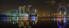 Marina Bay Panorama (eugene_zem) Tags: urban panorama water architecture reflections singapore nightlights waterfront outdoor ngc illuminated nightcity marinabay gardensbythebay singaporeflyer marinabaysands nightbuildings natgeoru