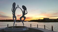 Dancing (Whistler Whatever) Tags: sunset sun lake canada art sunrise cityhall nwt midnight northwestterritories yellowknife statute framelake