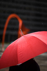 Calder (mollyporter) Tags: red chicago rain umbrella bokeh flamingo calder